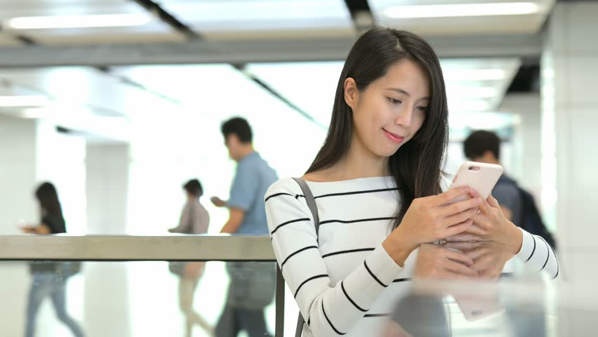 Woman using mobile phone in train station | Shutterstock HD Video #25729589