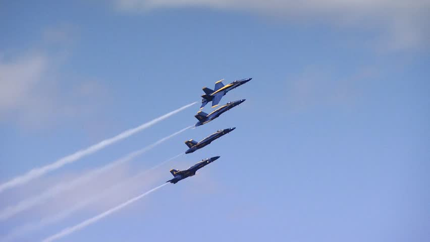QUONSET, RHODE ISLAND - CIRCA JUNE 2012: Four Blue Angels jets breaking away one plane at a time