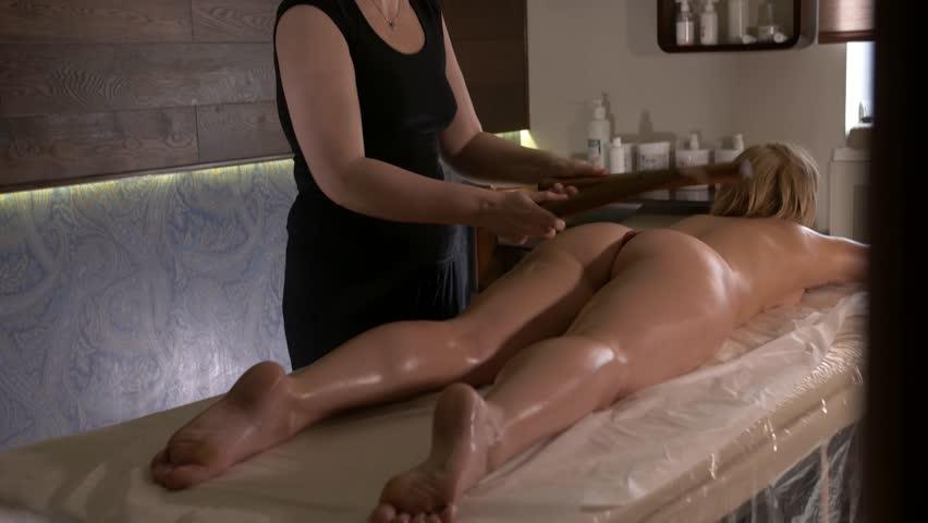 Young woman getting bamboo massage. | Shutterstock HD Video #25929713
