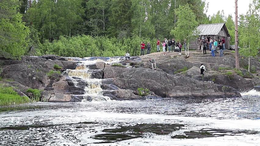 RUSKEALA, KARELIA, RUSSIA - CIRCA JUNE 2012: Tourists are in Ruskeala waterfalls - four falls flat in Sortavala region on the river Tohmajoki on circa June, 2012 in Ruskeala, Karelia, Russia - HD stock footage clip
