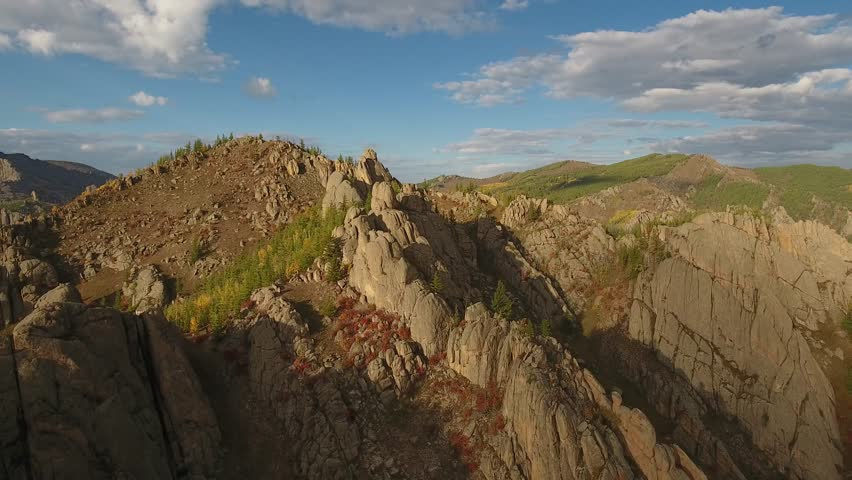 Park Terelj rocks and steppe near Ulaanbaatar Mongolia. Summer autumn sunny blue sky clouds. Beautiful aerial drone helicopter flight obove wild nature   Shutterstock HD Video #26078960