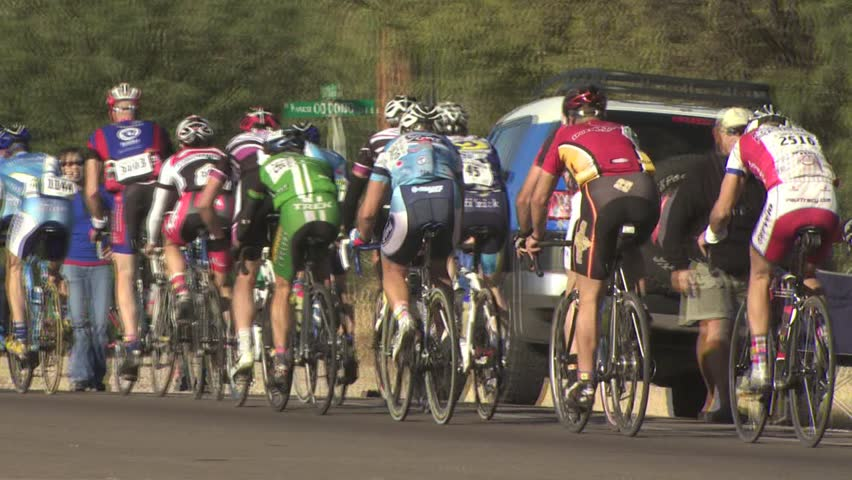 ARIZONA - CIRCA 2010: Cyclists In A Road Race As They Climb A Hill  | Shutterstock HD Video #2609858