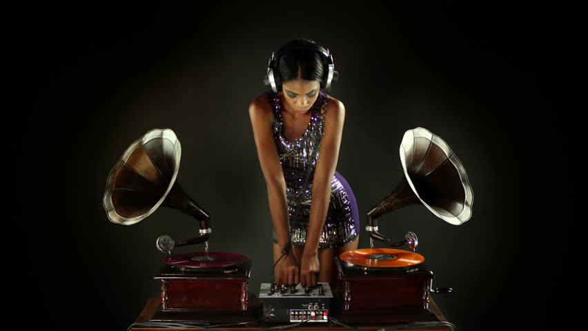 sexy young woman djs using two retro antique gramophones. cool and quirky concept clip - HD stock video clip