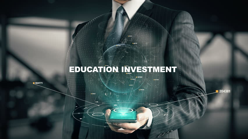 Businessman with Education Investment hologram concept | Shutterstock HD Video #26129630