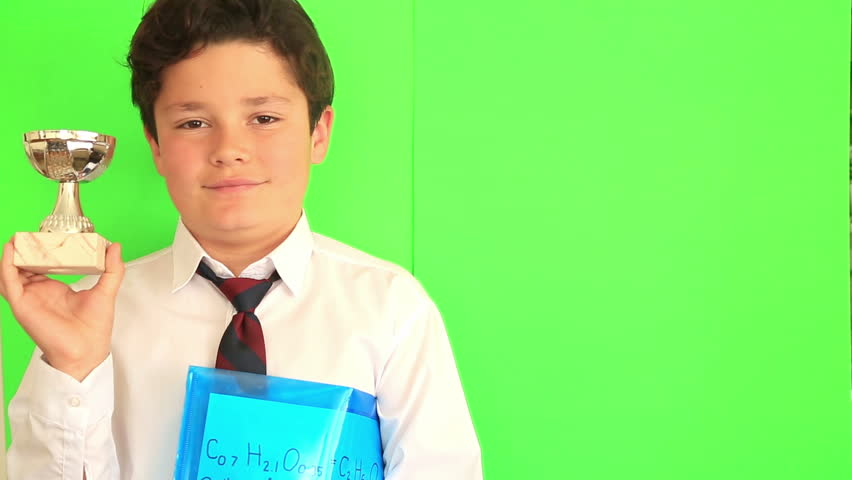 Elementary school boy receiving a trophy on chroma key green screen background | Shutterstock HD Video #26139809