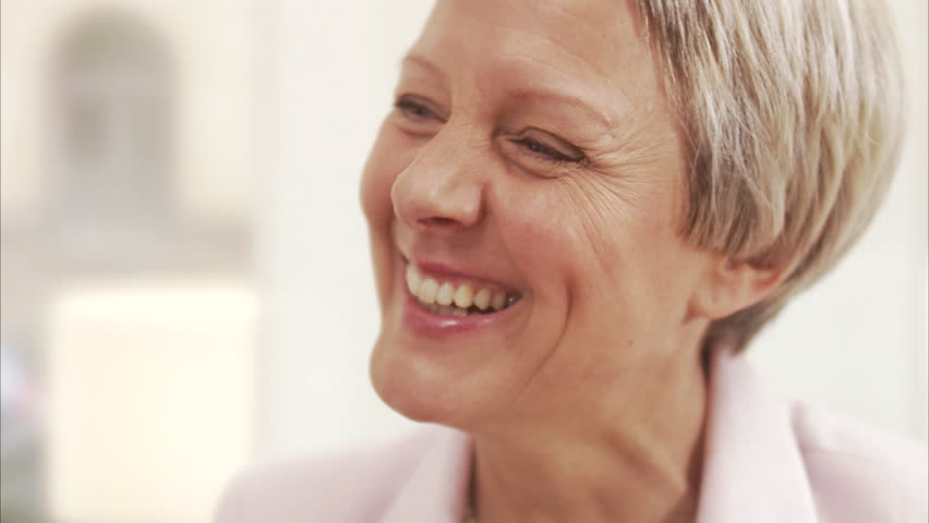 A smiling middle aged woman - HD stock footage clip