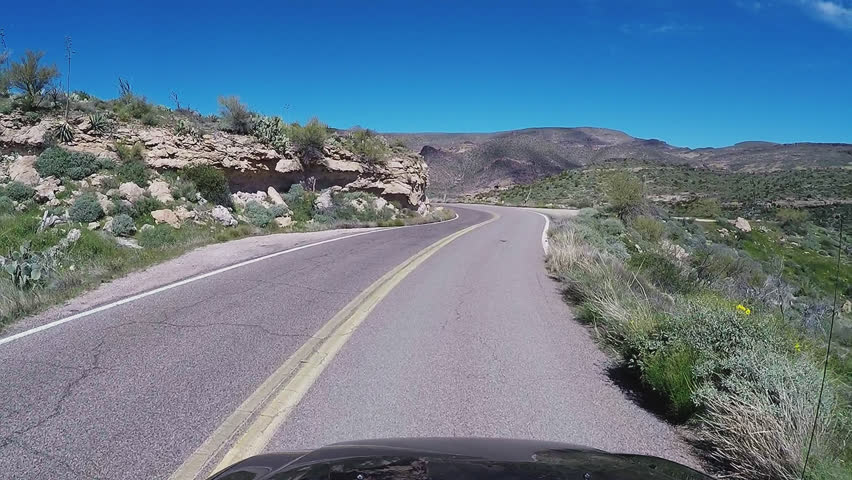 APACHE JUNCTION AZ/USA: March 23, 2017- View driving a curving steep Apache Trail with steep canyon. A first person view reveals driving with caution on potentially hazardous mountain road. | Shutterstock HD Video #26173478