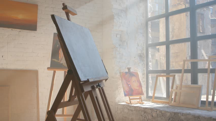 Clear canvas on wooden easel ready to be painted in art workshop | Shutterstock HD Video #26184872