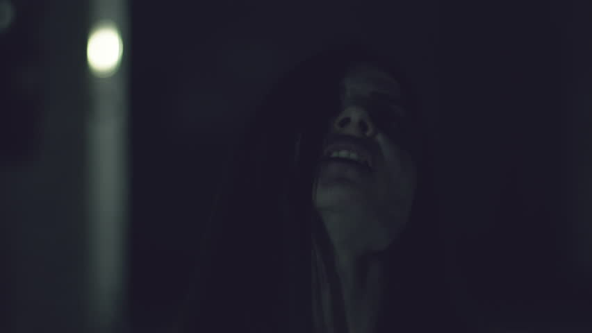 Female zombie coming out from darkness towards camera scary | Shutterstock HD Video #26192315