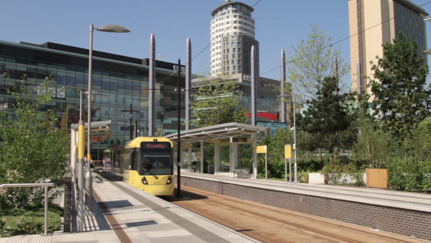 MANCHESTER, LANCASHIRE/ENGLAND - MAY 25: A brand new metrolink tram  leaves Salford Quays for Piccadilly on May 25, 2012 in Manchester. MediacityUK station opened in September 2010.