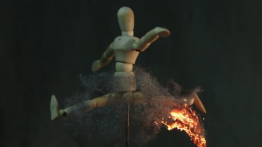 Skirt of a Wooden Mannequin Burns MAC - Fire travels throughout the steel wool skirt of a wooden mannequin as it turns | Shutterstock HD Video #26214860