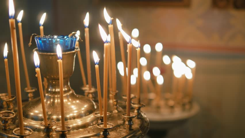 Burning candles on the altar | Shutterstock HD Video #26219765