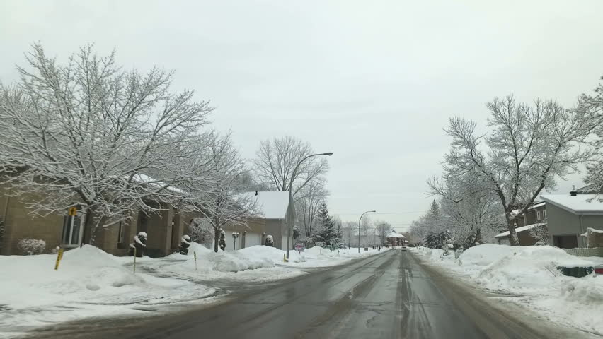 Winter Driving After A Snow Fall in Montreal | Shutterstock HD Video #26219864