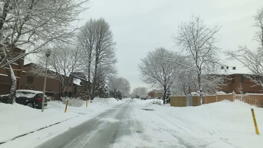Winter Driving After A Snow Fall in Montreal | Shutterstock HD Video #26219873