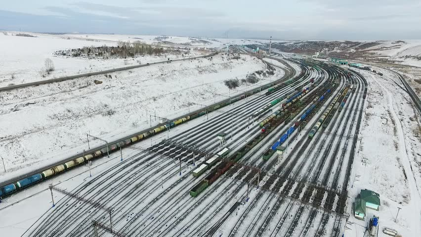 The railway station sorting of cars, Russia winter in Siberia, shooting from air | Shutterstock HD Video #26220791