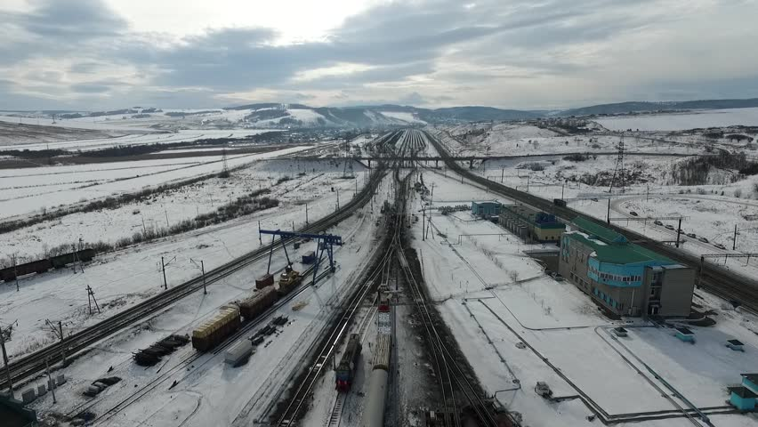 The railway station sorting of cars, Russia winter in Siberia, shooting from air | Shutterstock HD Video #26220800