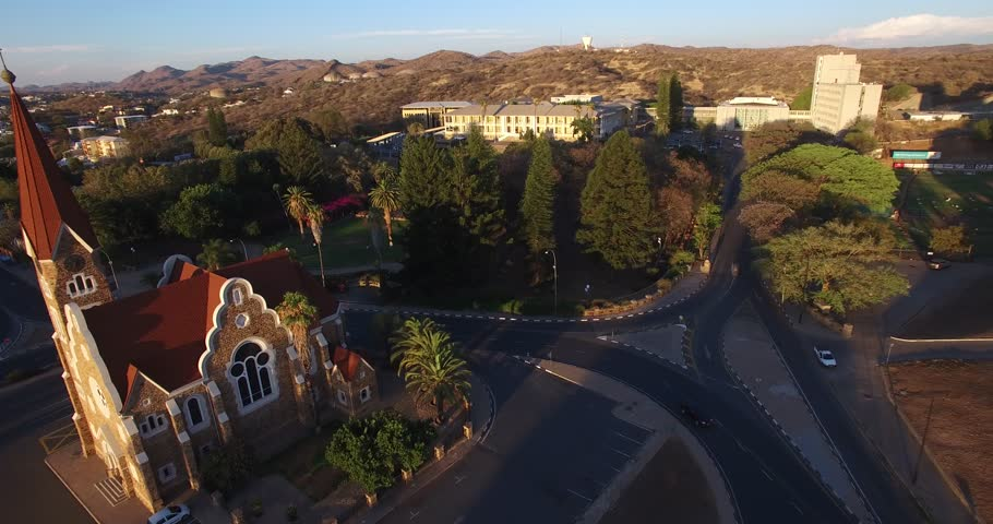 Aerial drone video with view of old historical fort in city center of Windhoek, other old buildings and church in town in central highland Khomas Hochland of Namibia, southern Africa | Shutterstock HD Video #26221565