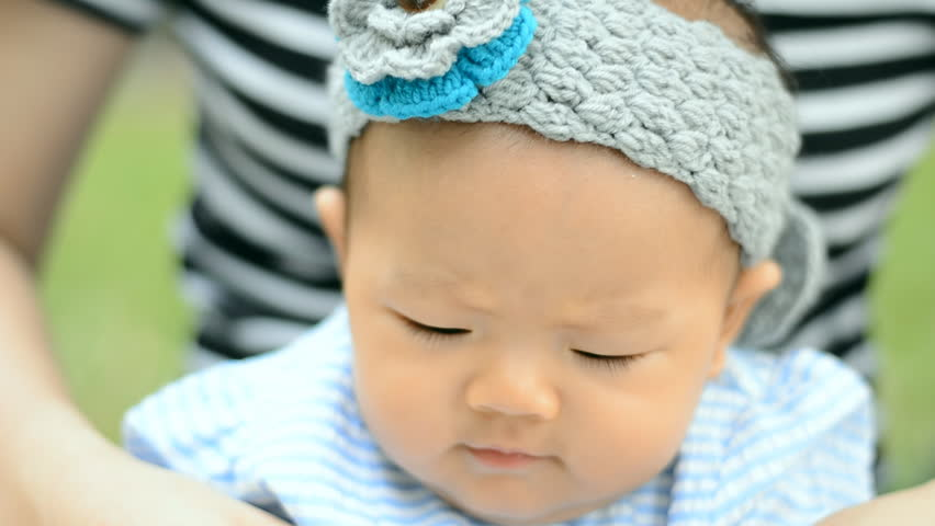 Cute Asian baby sitting and playing at park  | Shutterstock HD Video #26223131