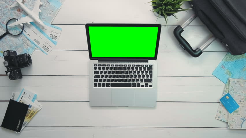 Top view traveler's hands using laptop computer with green screen at white wooden desk | Shutterstock HD Video #26223995