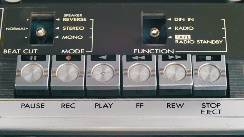 Pushing Play, Stop and Record on a Vintage Tape Recorder. Close-up. Pushing Finger Buttons on Retro Player. Man finger presses playback control buttons on audio cassette player. | Shutterstock HD Video #26224022