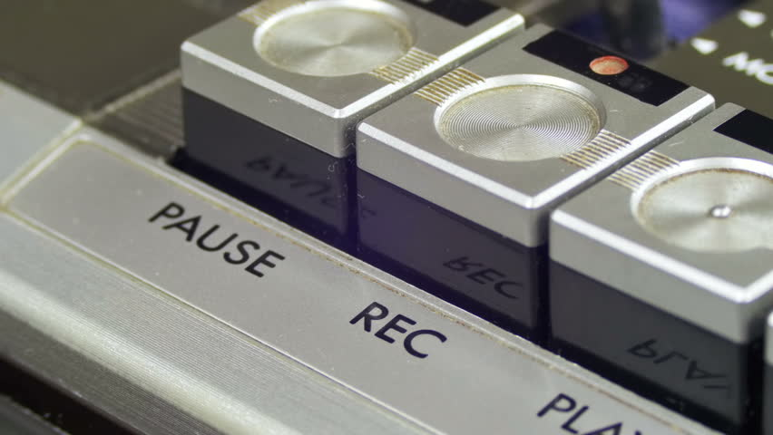 Pushing Record Button on a Vintage Tape Recorder. Close-up. Pushing a Finger Button Record. Man finger presses playback control buttons on audio cassette player. | Shutterstock HD Video #26224031