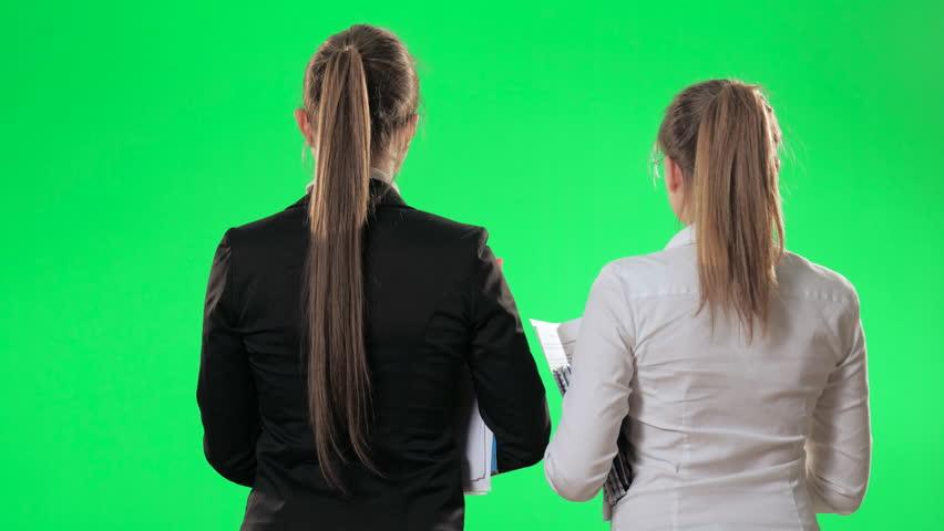 Two secretaries are talking in the elevator, green screen, alpha  | Shutterstock HD Video #26225525
