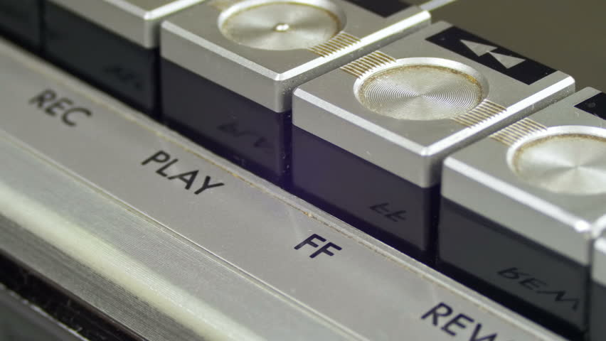 Pushing Forward Button on a Vintage Tape Recorder. Close-up. Pushing a Finger Button Forward. Man finger presses playback control buttons on audio cassette player. | Shutterstock HD Video #26232356