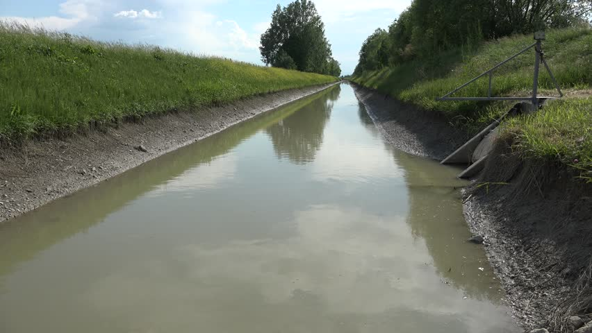 Calm water flowing in irrigation canal | Shutterstock HD Video #26235056