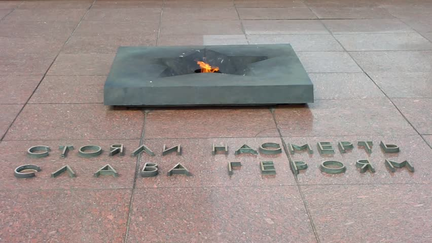 """BREST, BELARUS - AUGUST 4: The Eternal Flame at the Brest Fortress on August 4, 2012 in Brest, Belarus. The inscription reads """"Stood up to the end / Glory to the heroes."""" - HD stock footage clip"""