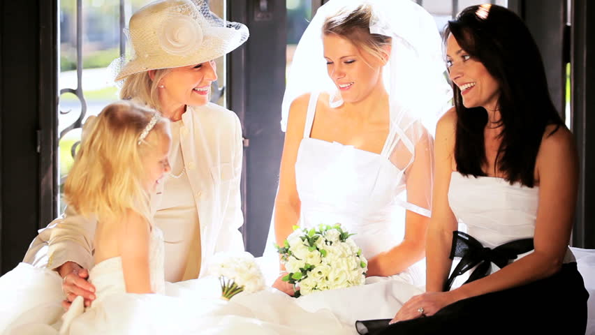 Beautiful Young Blonde Bride Wedding Dress Sitting With