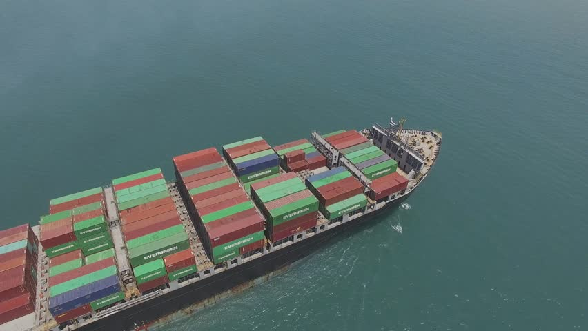 Athens, Greece - April 30, 2017:Aerial footage of  a medium size container ship at sea, loaded with various brands of international shipping containers. | Shutterstock HD Video #26365637