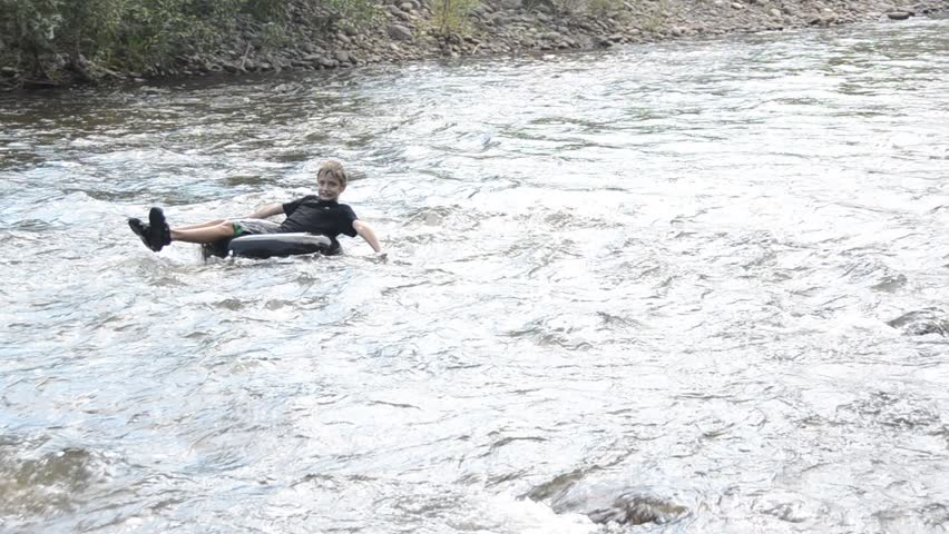 adventurous boy braves the rapids - HD stock footage clip