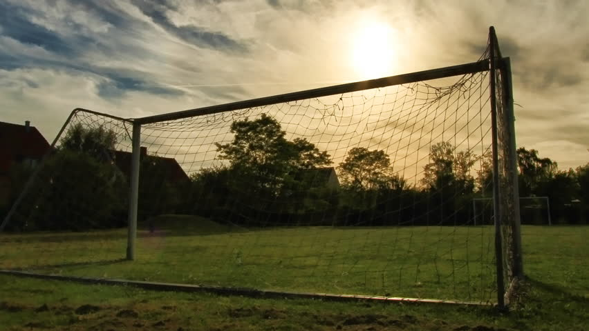 Soccer Goalposts at sunset with slight zoom out. This is still frame animation from uncompressed 35mm digital stills shot on the highest quality Canon L lens. - HD stock footage clip