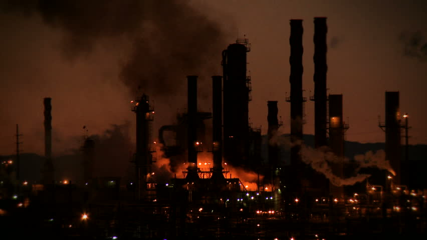 A fire burns against the night sky at an oil refinery in Richmond, California.