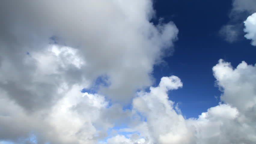 A cloudscape time lapse with dramatic large clouds set against a deep blue sky over the Atlantic Ocean in Kerry County, Ireland. This is still frame animation from high quality 35mm digital stills. - HD stock video clip