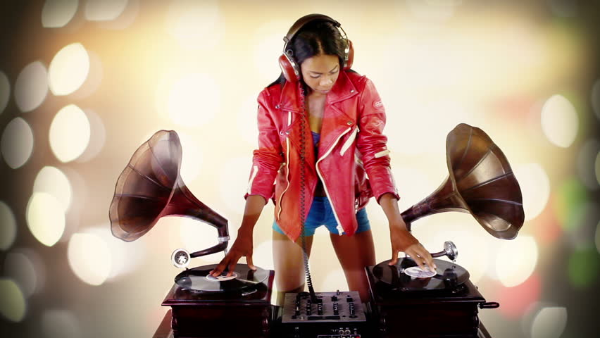 sexy young woman djs using two retro antique gramophones. cool and quirky concept clip