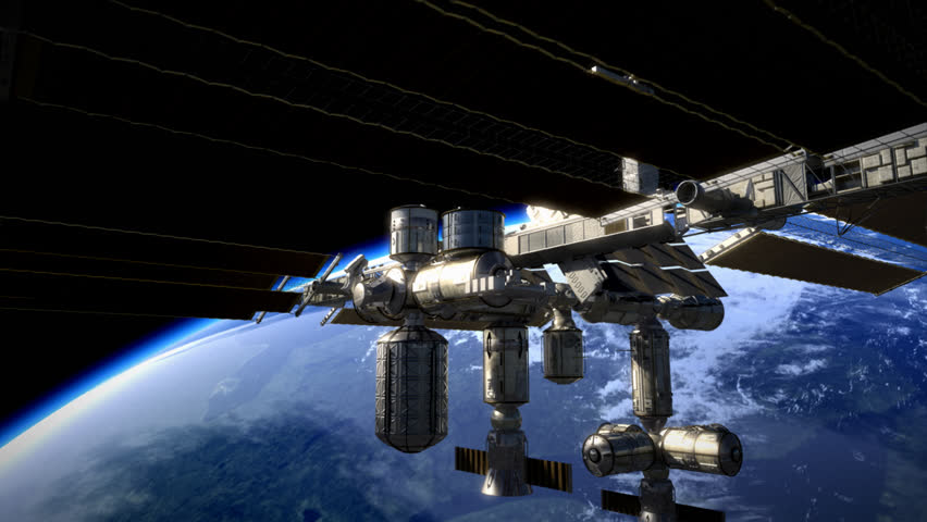 Space station tilt shot in orbit around earth