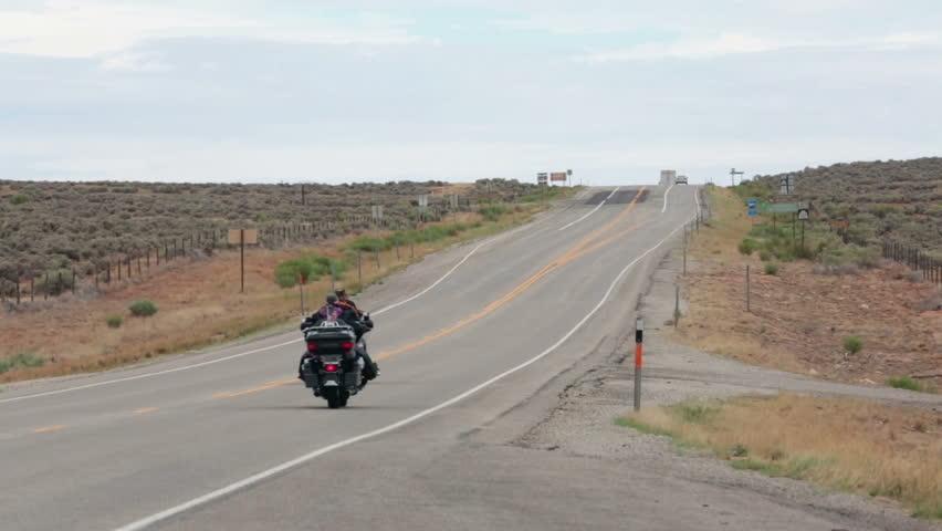 Motorcycle club cruise down desert highway road in Southern Utah - HD stock footage clip