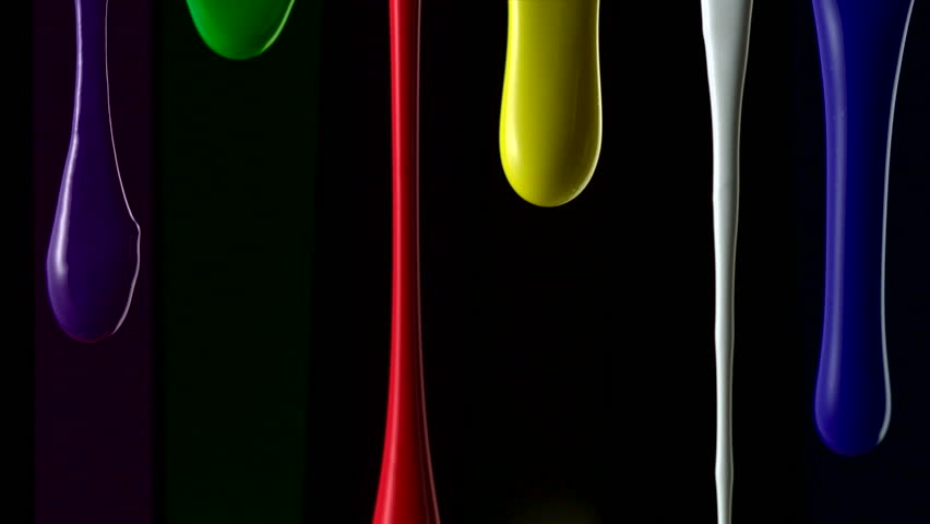 Paint dripping on black background shooting with high speed camera. - HD stock video clip