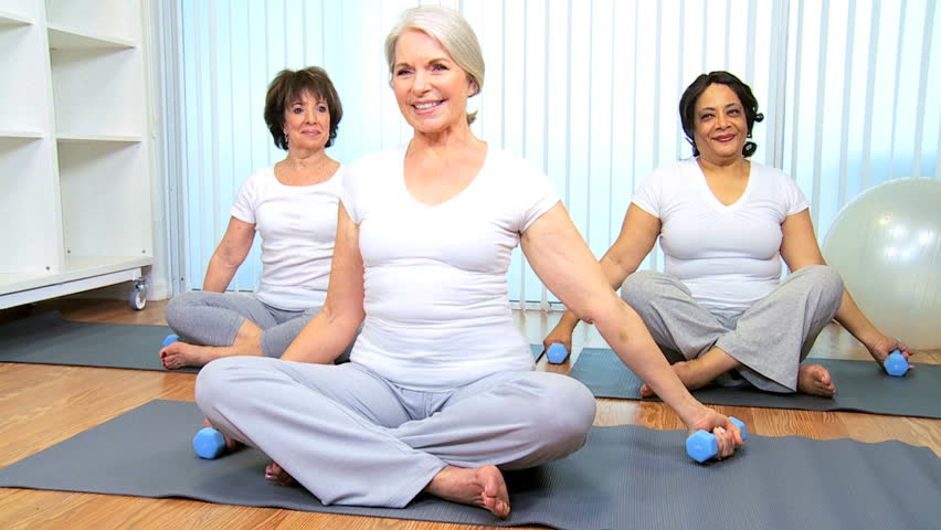 Yoga group older ladies health club class - HD stock footage clip