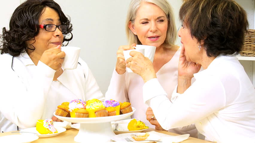 Three senior lady friends enjoying social afternoon with tea and cakes - HD stock video clip