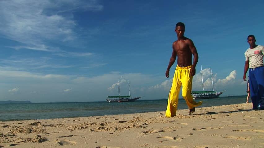 SALVADOR, BRAZIL - April 2008: Capoeira artist performs on the beach in Salvador, Bahia, Brazil