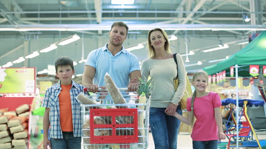 Smiling family of four enjoying shopping together | Shutterstock HD Video #2707715
