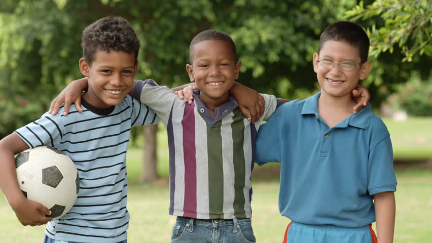 Young boys and sport, portrait of three happy young children with soccer ball smiling and looking at camera | Shutterstock HD Video #2709542