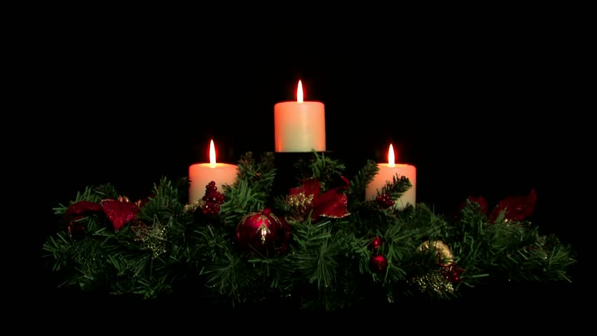 Holiday centerpiece with three tiered white candles stock
