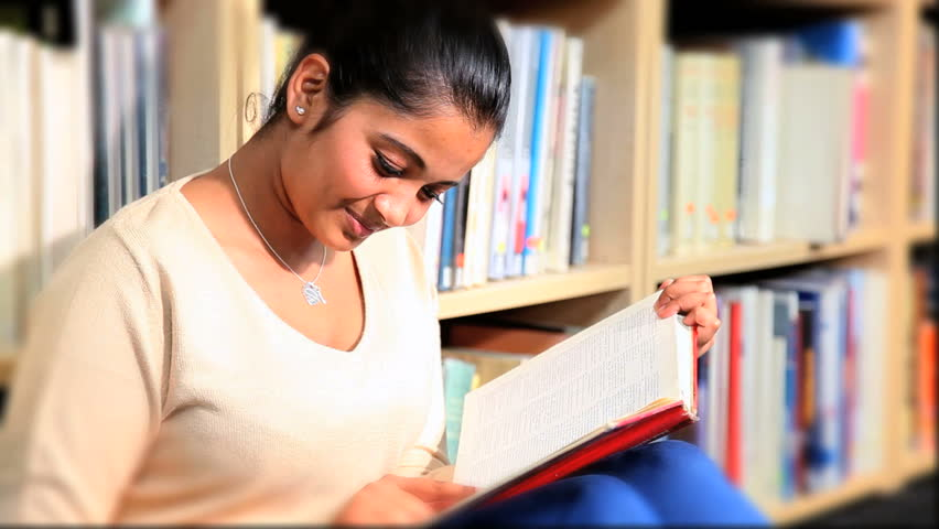 Indian Graduate Female Student Study Textbook In