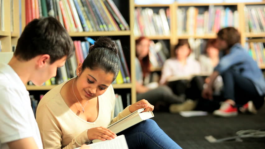 College class of multi ethnic young students learning in modern information library - HD stock footage clip