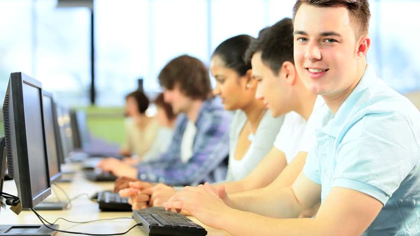 Multi Ethnic Happy Creative Students Working On Computers ...