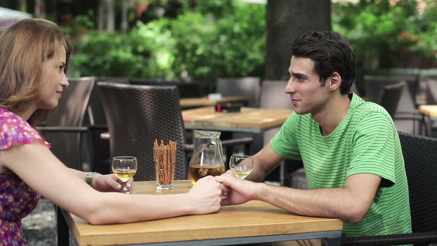 Happy couple in love holding hands in cafe, steadicam shot  - HD stock video clip