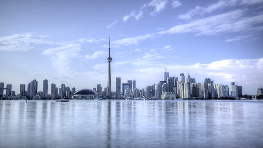 HDR Time lapse Toronto Skyline and CN Tower with Rogers Center daytime